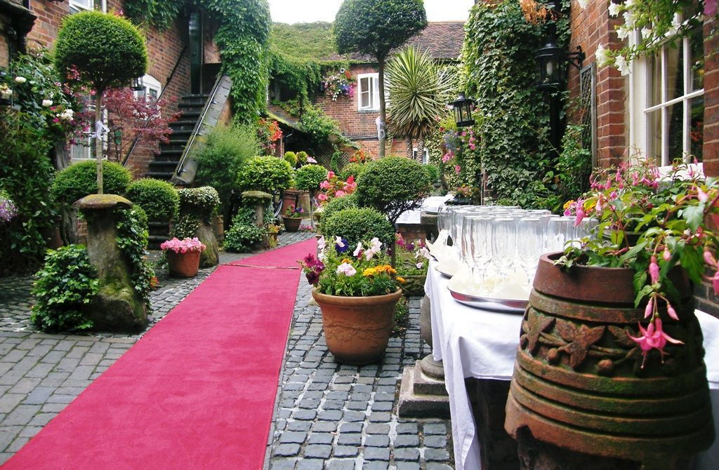 Red carpet courtyard wedding, The Greyhound Coaching Inn
